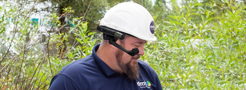 DMT Service Manager wearing E&H glasses and hard hat